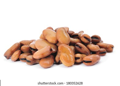 a pile of cooked bread beans on a white background