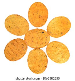Pile of corn chips with spices top view isolated on white background.