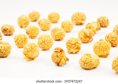 A pile of cream caramel popcorn on a white background