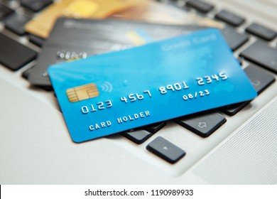 Pile of credit cards on the laptop keyboard. Open access for online shopping