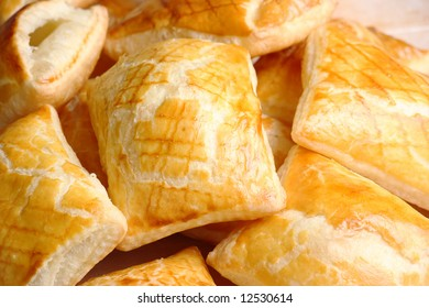 Pile of crisp puff cakes filled with jelly