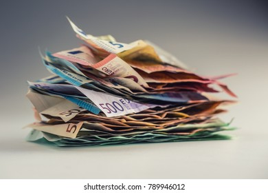 Pile of crumpled euro banknotes.