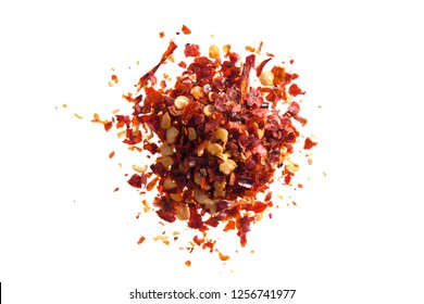 Pile crushed red cayenne pepper, dried chili flakes and seeds isolated on white background