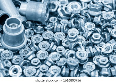 The pile of custom hexagon nut for special purpose in the light blue scene.The industrial corrosion free nut and bolt manufacturing concept.