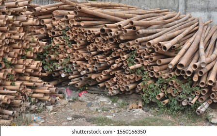 A pile of cut bamboo wood for construction ( texture, background, pattern)
