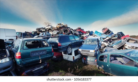 Pile of damaged cars on scrap yard metal recycling