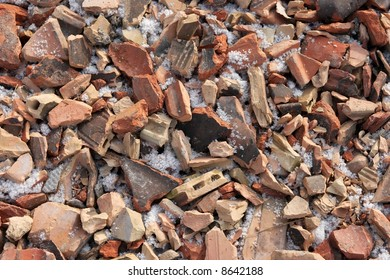 A pile of debris, broken pieces of brick