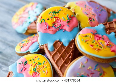 Pile of decorated cookies. Frosting of bright colors. Make a surprise for kids. Treats with sugar icing.