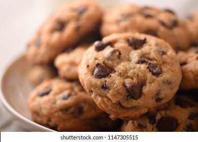 Pile of Delicious Chocolate Chip Cookies on a White Plate