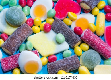 Pile of delicious colorful chewing candies background. Colourful sweets