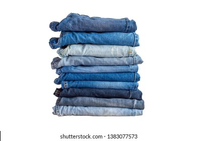 pile of denim blue jeans stack isolated on white background