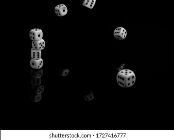 Pile of dices on a black table