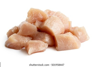 Pile of dices skinned deboned raw chicken breast isolated on white.