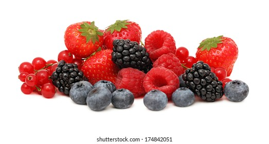 Pile of different berries (blueberry, raspberry, strawberry, red currant and blackberry) isolated on white background