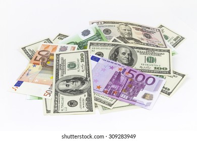 Pile of different currencies isolated on white background