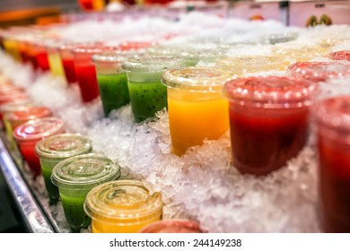 Pile of different fresh squeezed juices