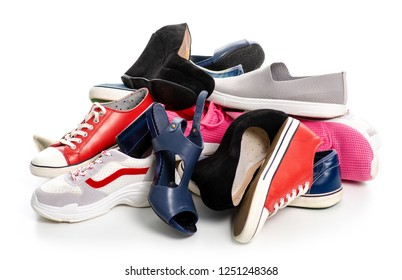 A pile of different shoes sneakers on a white background. Isolation