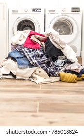 Pile of dirty clothes in laundry room with copy space