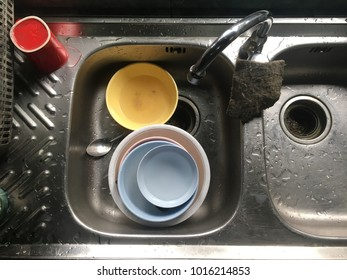 Pile of dirty dish in the sink, wash dish, top view.