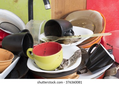 Pile of dirty dishes in the sink