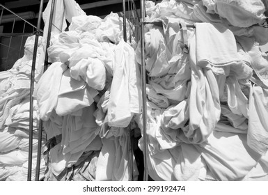 pile of dirty laundry in the industrial laundry before washing