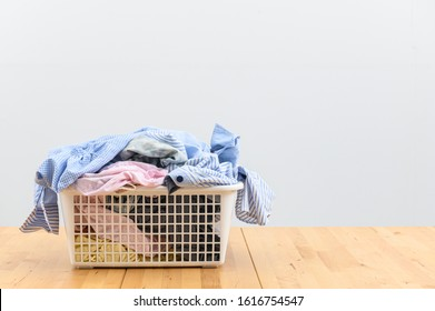 Pile of dirty laundry in a washing basket.