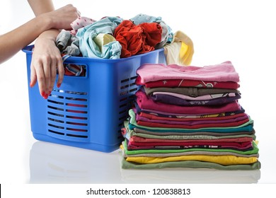 Pile of dirty and washed clothes on isolated background