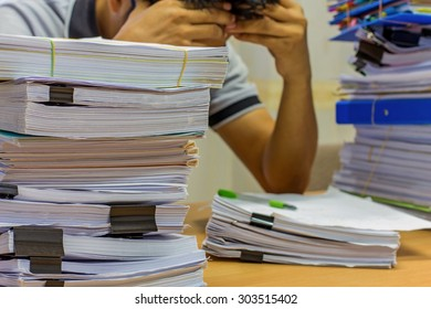 Pile of documents on desk for managed.