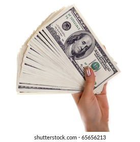 Pile of dollar s banknotes in female hand on white background