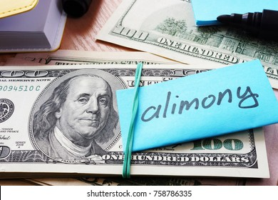 Pile of dollars with word alimony on a stick.