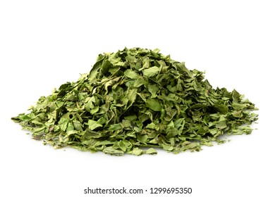 A pile of dried chopped coriander leaves isolated on white.