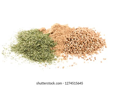 Pile of dried cilantro leaves, whole coriander seeds and coriander powder.  Isolated on a white background.