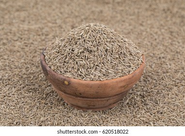 Pile of Dried Cumin Seeds Also Know as Caraway, jira or jeera Its seeds are used in the cuisines of many different cultures