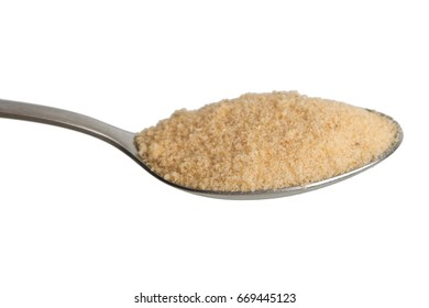 Pile of dried garlic spice in spoon. Isolated on white background.