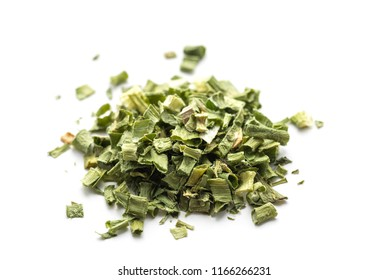Pile of dried green onion on a white background.