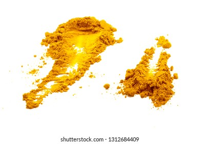 Pile of dried ground turmeric powder spread out on white background - isolated
