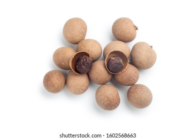 Pile of dried longan isolated on white background. Top view.