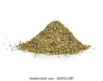 a pile of dried oregano on a white background