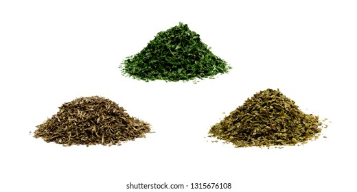 Pile of dried oregano, thyme, and parsley on white background