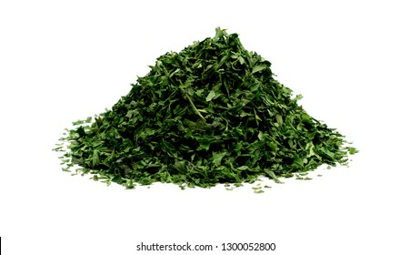 Pile of dried parsley over white background close up