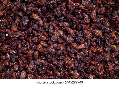 Pile of dried raisins for background with top view.