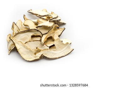 Pile of dried sliced shiitake with copy space on white background