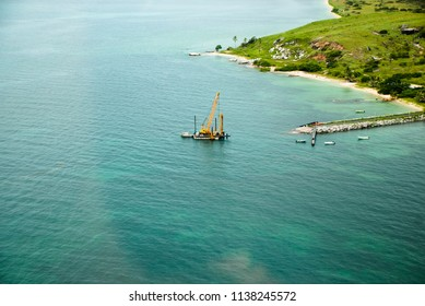 Pile driving Barge working at St Pauls, Moa Island, Torres Straits Australia