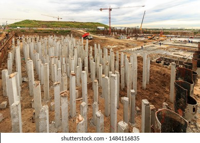 Pile driving in foundation pit construction apartment building. Piling driven ground. Deep foundation installation. Reinforce prestressed concrete piles factory foundation construction Moscow 08/2019