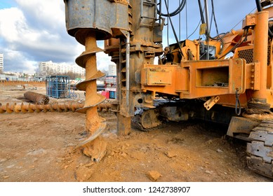 Pile driving machine on a construction site.