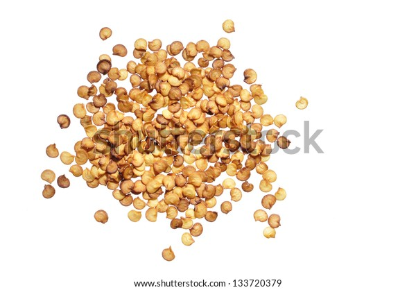 Pile of dry chili pepper seeds isolated on white background