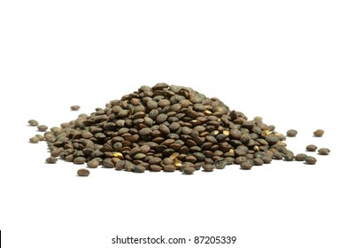 Pile of dry  french green puy lentils, isolated on the white background