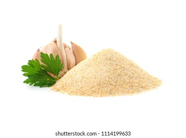 Pile of dry garlic powder and parsley on white background