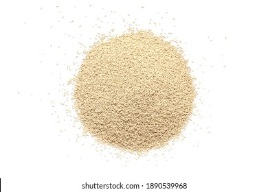 Pile of dry yeast isolated on white background, top view. Active dry yeast on a white background, top view. Dry yeast granules isolated on white background. Dry yeast is used in baked goods.