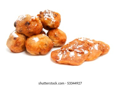 Pile of Dutch donut also known as oliebollen and apple turnovers, traditional New Year's eve food isolated on white background